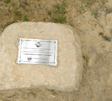 FBA plaque on rock